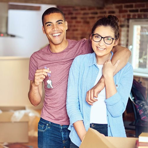 Couple in new home holding keys