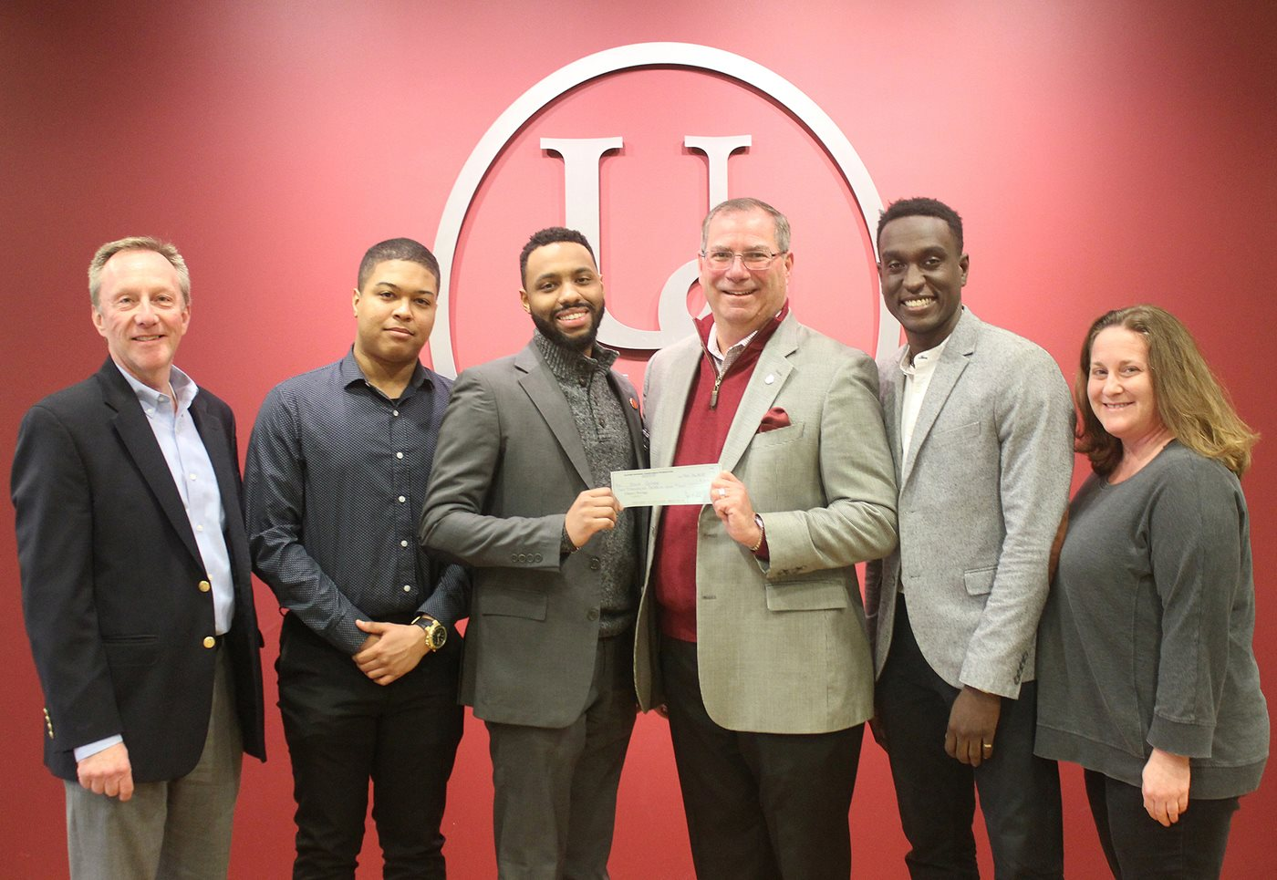 Brothers at Bard Receiving Grant Check