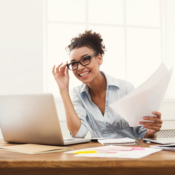 Woman looking at computer and smiling