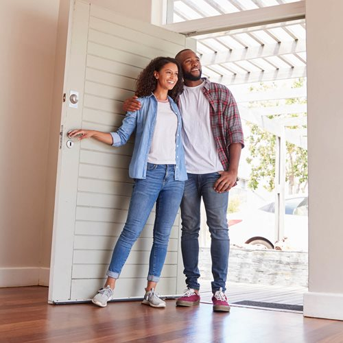 Couple Opening Door to New House